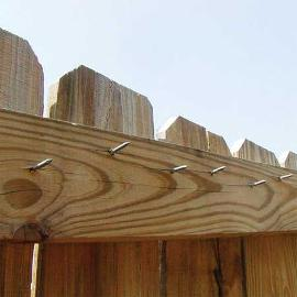 Here the owner repaired his own fence, but kind of went overboard on the length of the nails (unless he really dislikes his neighbor). If you're going to do your own repair, use the right tool for the job.